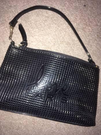 Bolsa/Clutch negra Paris hilton