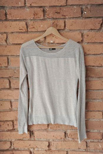 Suéter con tachas