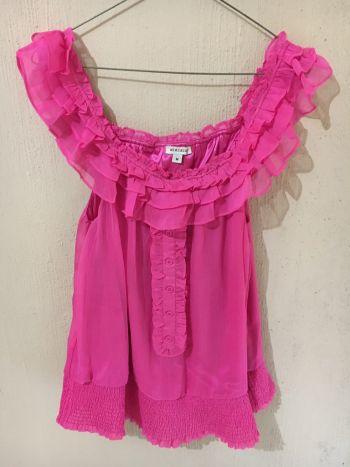 Blusa de vestir con holanes rosa