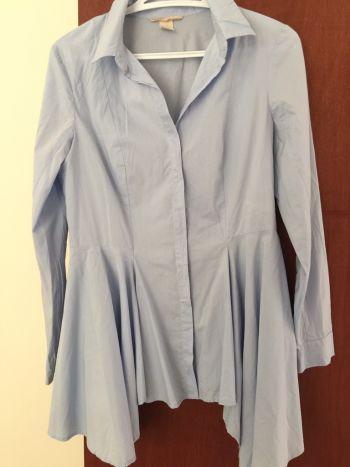 Camisa corte asimetrico y acinturada