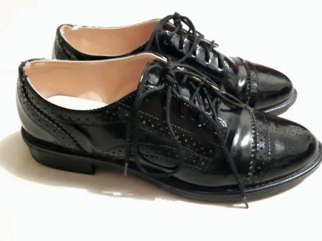 Zapatos negros tipo oxford