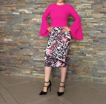 Blusa rosa mangas en campana