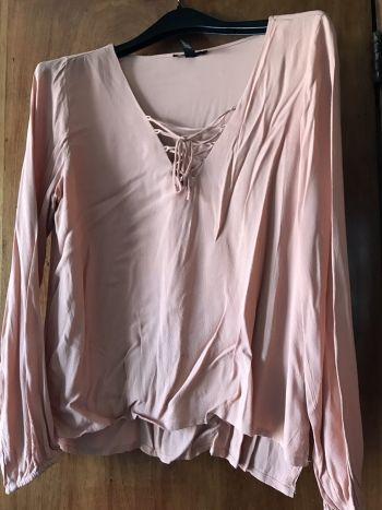 Blusa con cintas rosa