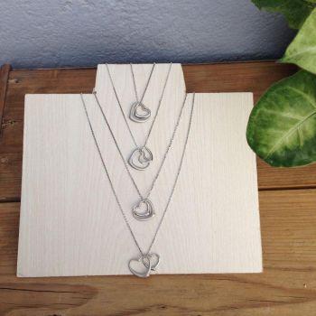 Los 4 Collares de Corazon Doble