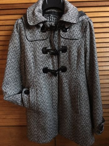 Abrigo jaspeado blanco con negro