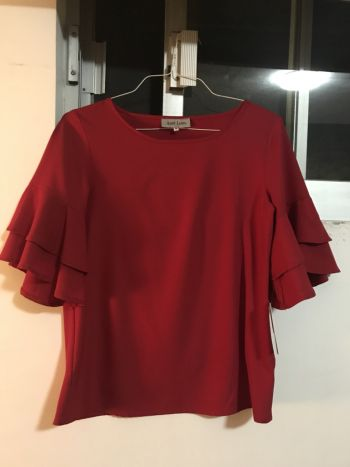 Blusa roja con mangas